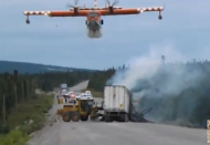VIDEO: Water Bomber Plane Drops Load on Vehicle Fire